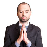 Businessman making a prayer. Stock Photo