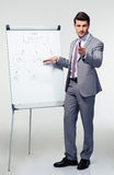 Businessman making presentation on flipchart Stock Photo