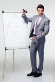 Businessman making presentation on flipchart Royalty Free Stock Photography
