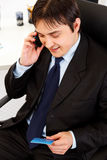 Businessman making purchase by phone and ca Stock Photos