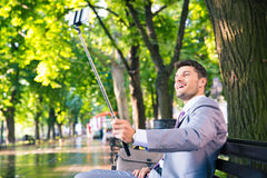 Businessman making selfie photo on smartphone Royalty Free Stock Photography