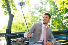 Businessman making selfie photo on smartphone Royalty Free Stock Image