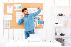 Businessman making selfie while standing in front of office board Stock Image