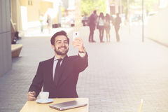Businessman making selfies in city centre Royalty Free Stock Photo