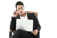 Businessman making a serious phone call Royalty Free Stock Photos