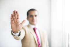 Businessman making STOP sign with a hand gesture. Royalty Free Stock Photography