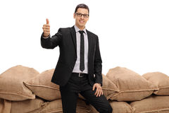 Businessman making a thumb up sign Royalty Free Stock Images