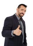 Businessman making thumb up sign Stock Photos