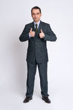 Businessman making the thumbs up gesture Stock Photo