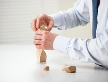Businessman making tower of wooden blocks Stock Image