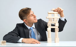 Businessman making tower Stock Photo
