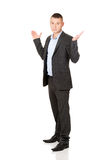 Businessman making undecided gesture Royalty Free Stock Photos