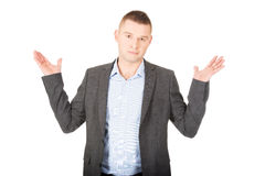 Businessman making undecided gesture. Young businessman making undecided gesture Stock Photography