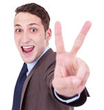 Businessman making the victory hand gesture Royalty Free Stock Photography