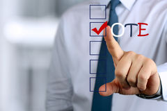 Businessman  making vote  by  a red  pen Stock Photo