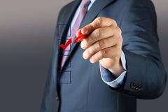 Businessman  making vote  by  a red  pen Stock Images