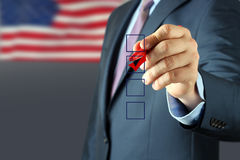 Businessman  making vote  by  a red  pen Royalty Free Stock Photos