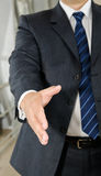 Businessman male hand reached to seal the agreement Stock Photos