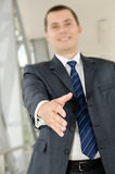 Businessman male hand reached to seal the agreement Royalty Free Stock Photos