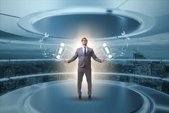 The businessman man with robotic arms Stock Images