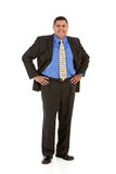 Businessman:  Man Standing with Hands on Hips. Series of a Hispanic businessman in suit, isolated on white, with props, in various poses Stock Images