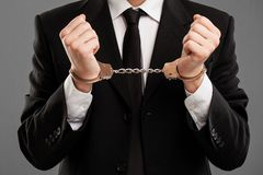 Businessman with manacles on his hands Stock Photography
