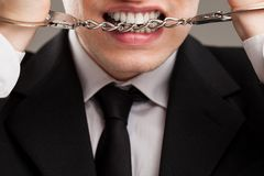 Businessman with manacles on his hands Royalty Free Stock Image