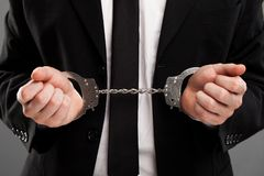 Businessman with manacles on his hands Stock Photo