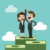 Businessman or manager and businesswomen is standing on a big pile of money. Team work Stock Image