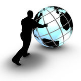 A businessman manages a world wide project by rolling the globe Stock Images
