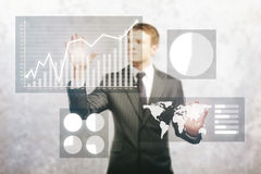 Businessman managing business diagrams Stock Image