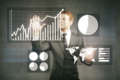 Businessman managing business graphs Royalty Free Stock Images