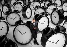 Businessman and many clock Royalty Free Stock Photography