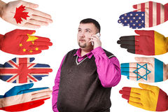 Businessman and many hands with different flags Stock Photo
