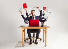 Businessman with many hands in elegant suit working with paper, document, contract, folder, business plan. Businessman with many hands in elegant suit working stock photo
