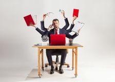 Businessman with many hands in elegant suit working with paper, document, contract, folder, business plan. Businessman with many hands in elegant suit working royalty free stock image