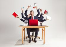 Businessman with many hands in elegant suit working with paper, document, contract, folder, business plan. Businessman with many hands in elegant suit working royalty free stock photos