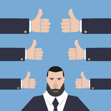 Businessman with many hands  thumbs up on a blue background Royalty Free Stock Photography
