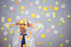 Businessman with many notes Royalty Free Stock Photography