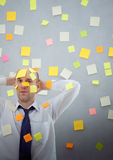 Businessman with many notes Stock Photography