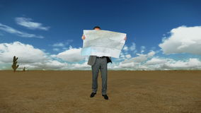 Businessman with Map in Desert with Time Lapse Clouds, stock footage. Video stock footage