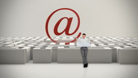 Businessman with Map trying to find his way in a Maze with Internet Mail Sign, Alpha Matte, stock footage Stock Image