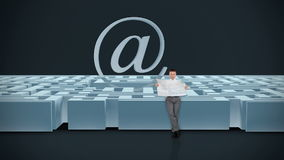 Businessman with Map trying to find his way in a Maze with Internet Mail Sign, dark room, stock footage Stock Photos