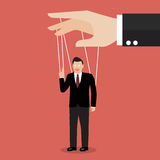Businessman marionette on ropes Stock Photography