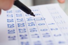 Businessman marking date on calendar in office Stock Photos