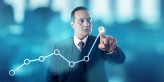 Businessman Marking Growth Trend In Line Chart Stock Image