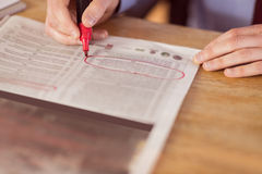 Businessman marking the newspaper with marker Stock Photo