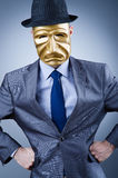 Businessman with mask concealing  identity Stock Photography