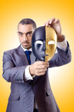 Businessman with mask Royalty Free Stock Photography