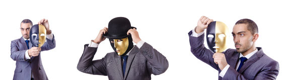 The businessman with mask in hypocrisy concept Stock Photo